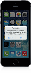 Image of iPhone with alarm notification using Alarm.com app.